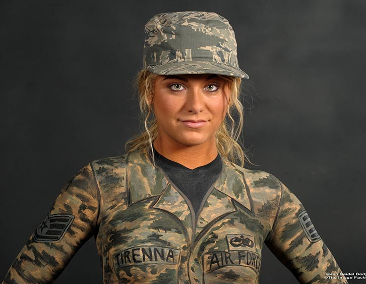 Models are body painted in military themes including army, navy, and ...