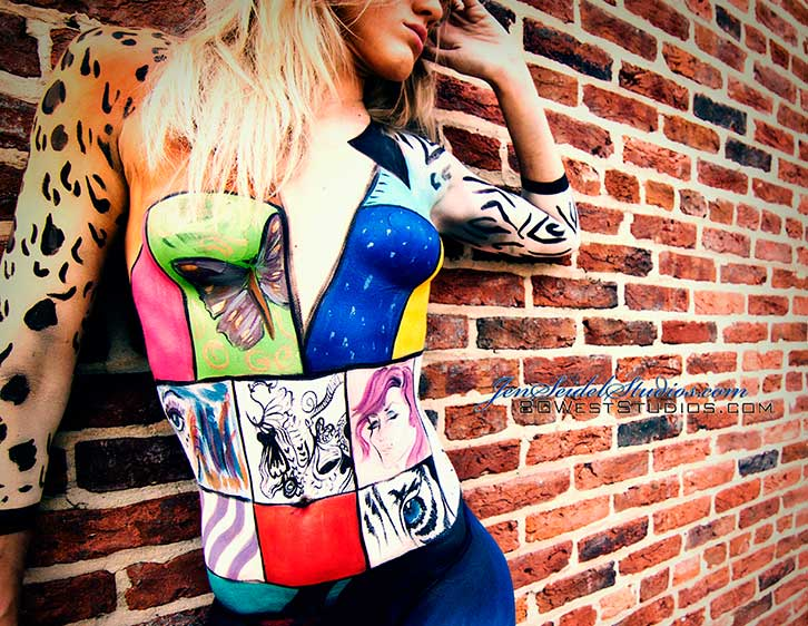 Jen paints a high fashion colorful design on model spread across brick wall
