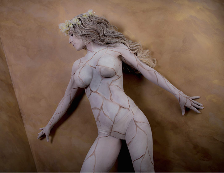 Jen Seidel models as a painted statue for photographer Chris West
